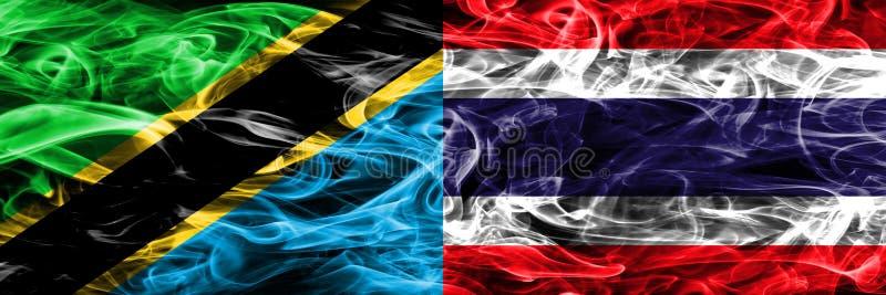 Tanzânia contra Tailândia, bandeiras tailandesas do fumo colocadas de lado a lado Bandeiras de seda coloridas grossas do fumo do  imagem de stock royalty free