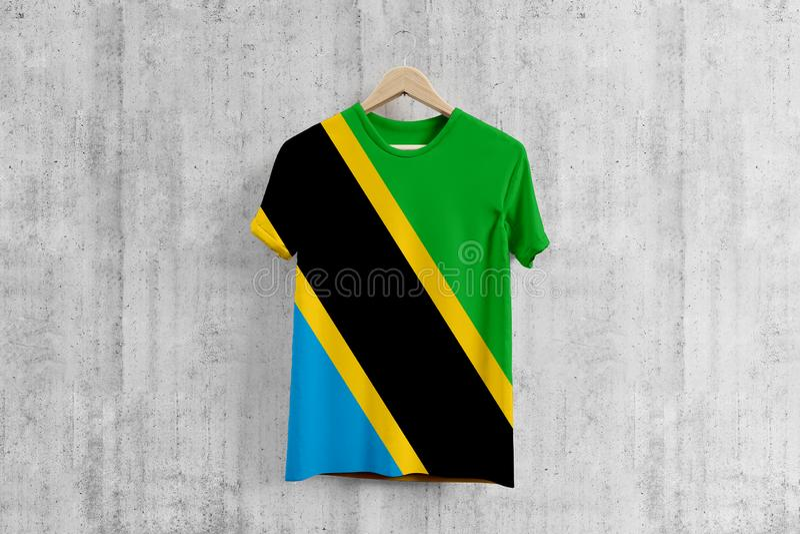 Tanzania flag T-shirt on hanger, Tanzanian team uniform design idea for garment production. National wear.  vector illustration