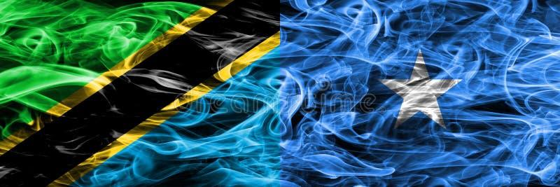 Tanzania vs Somalia, Somalian smoke flags placed side by side. Thick colored silky smoke flags of Tanzanian and Somalia, Somalian.  stock photos