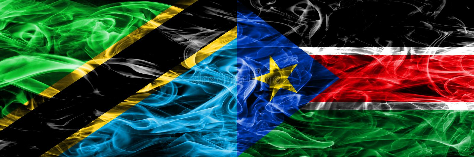 Tanzania vs South Sudan smoke flags placed side by side. Thick colored silky smoke flags of Tanzanian and South Sudan.  stock image