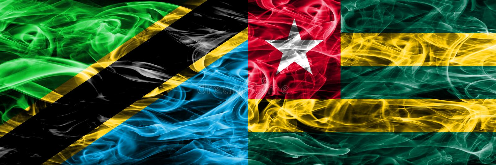 Tanzania vs Togo, Togolese smoke flags placed side by side. Thick colored silky smoke flags of Tanzanian and Togo, Togolese.  royalty free stock photo