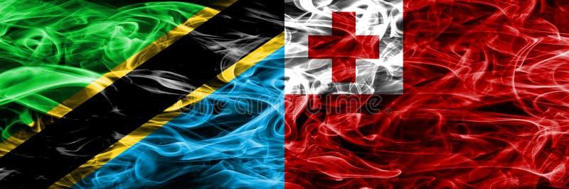 Tanzania vs Tonga, Tongan smoke flags placed side by side. Thick colored silky smoke flags of Tanzanian and Tonga, Tongan.  royalty free stock image