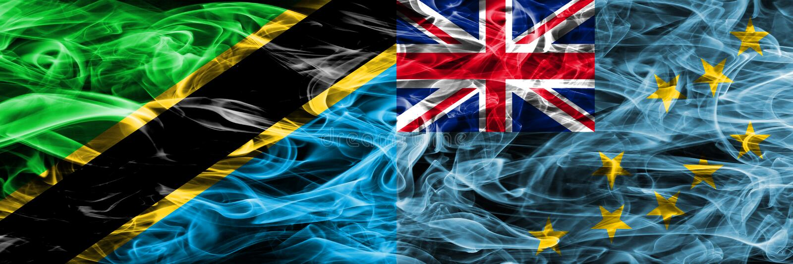 Tanzania vs Tuvalu, Tuvaluan smoke flags placed side by side. Thick colored silky smoke flags of Tanzanian and Tuvalu, Tuvaluan.  royalty free stock images