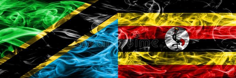 Tanzania vs Uganda, Ugandan smoke flags placed side by side. Thick colored silky smoke flags of Tanzanian and Uganda, Ugandan.  stock photos
