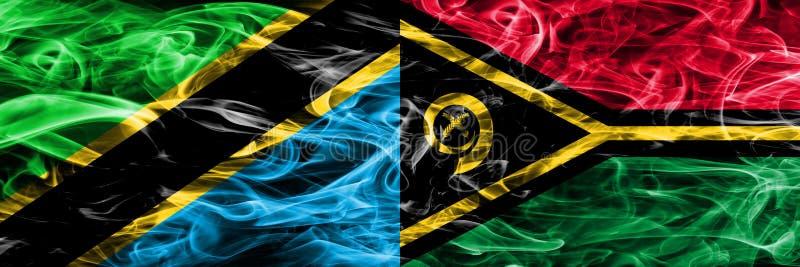 Tanzania vs Vanuatu smoke flags placed side by side. Thick colored silky smoke flags of Tanzanian and Vanuatu.  stock images