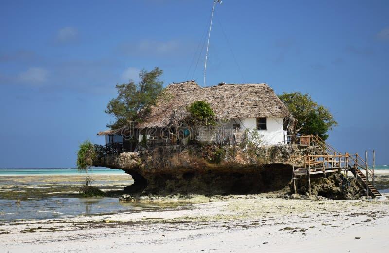 Tanzania, Zanzibar - February 2018. Unusual restaurant on the rock. royalty free stock photo