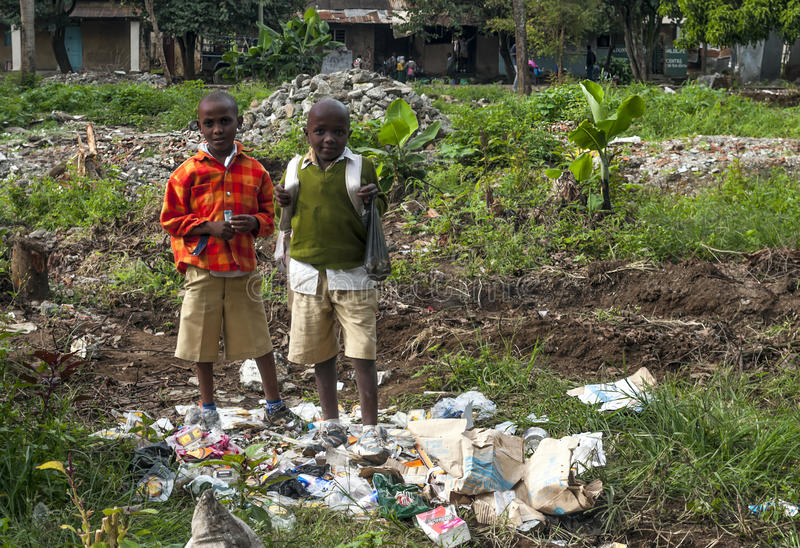Tanzanian boys in garbage. Is a image taken in May 2014 stock photography