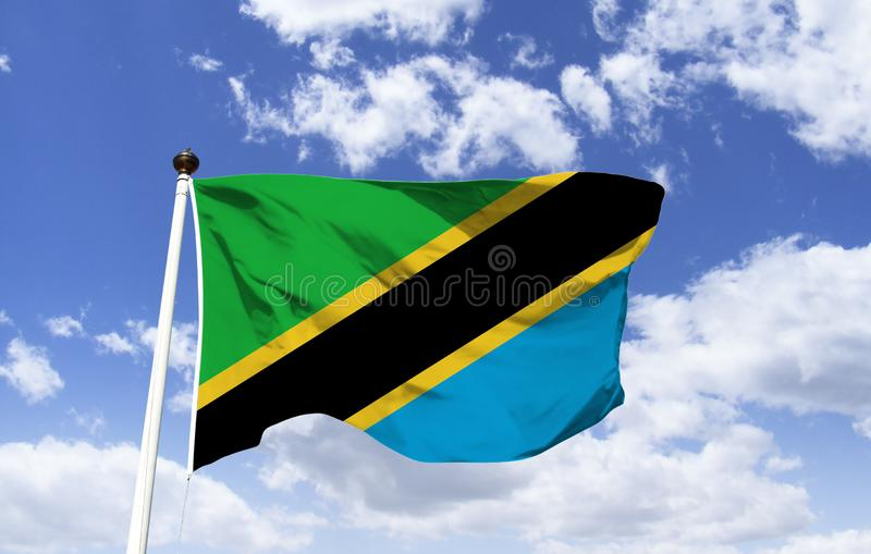 Tanzanian Flag Mockup, fluttering under the blue sky. Country in West Africa. Serengeti and Kilimanjaro National Park. Offshore the Zanzibar Islands and Arab stock image