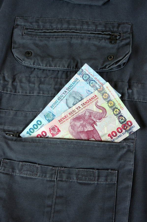 Tanzanian Shilling. Two banknotes of Tanzanian Shilling in the pocket of a garment royalty free stock photography