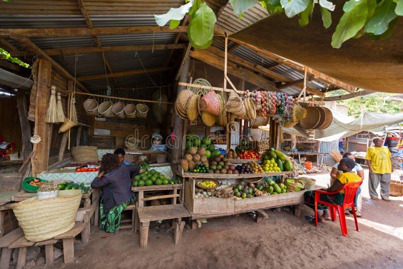 Tanzanian women selling handmade products, fresh local vegetables, fruit at Mto wa Mbu village, Arusha Region, Tanzania, East. TANZANIA, EAST AFRICA - APRIL 2018 stock images