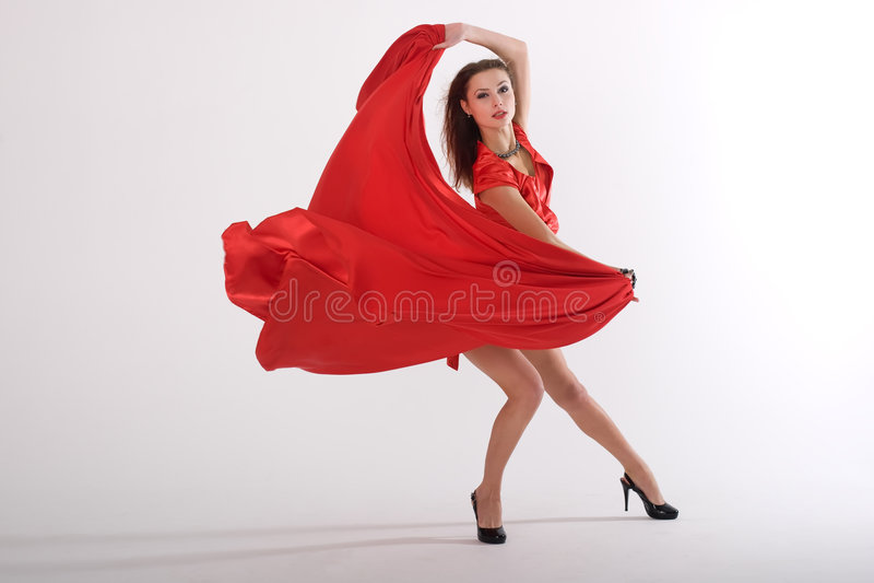 Tanzende reizvolle Dame stockfoto