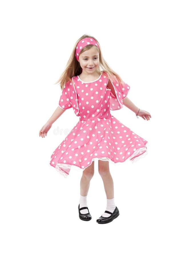 Tanzendes Kleines Mädchen Im Rosa Kleid Stockfoto - Bild von weiß ...
