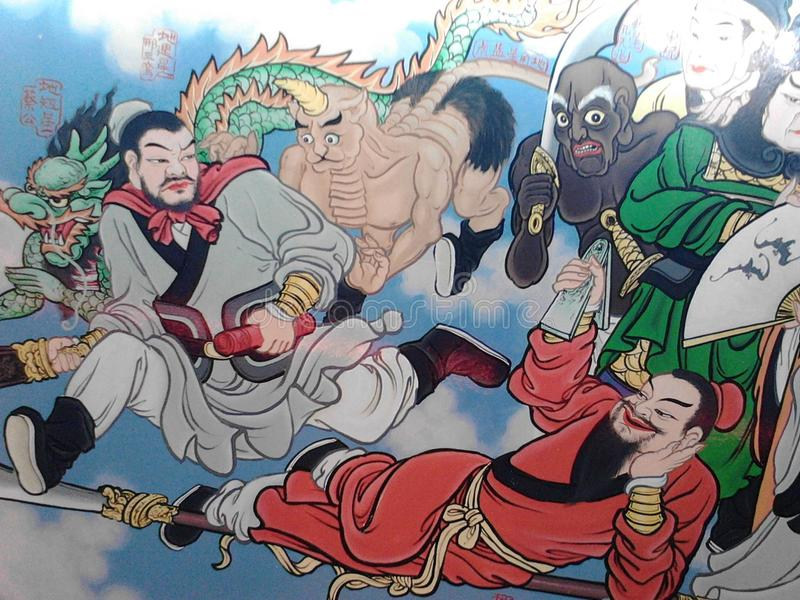 Taoist mural. Lessons on religious values are painted in temples to educate the visitors on the good and evil deeds in life and their consequences royalty free stock photo