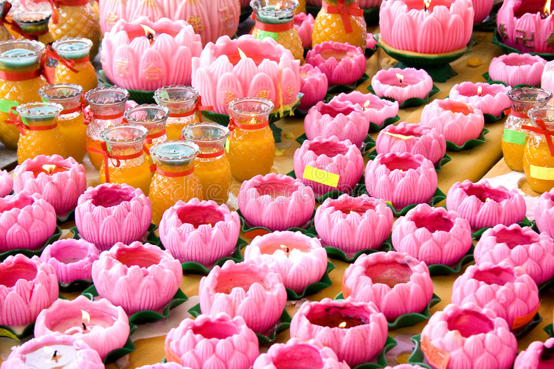 Taoist Prayer Offerings. Toaist prayer offerings of lotus shaped candles and jars at a temple royalty free stock image