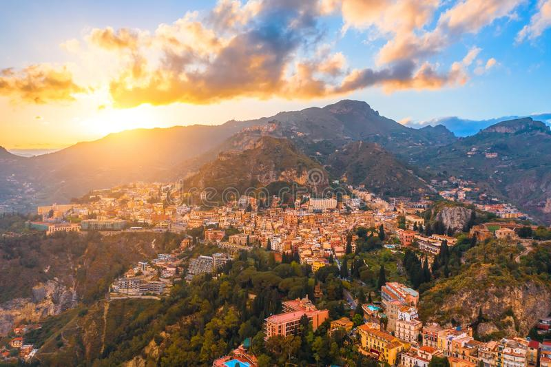 Taormina is a city on the island of Sicily, Italy. Aerial view from above in the evening at sunset stock photography