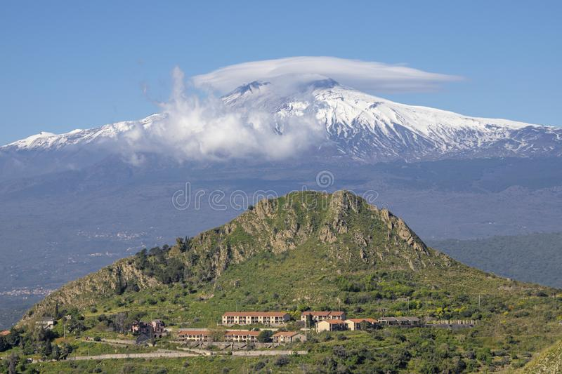 Taormina - The Mt. Etna volcano over the Sicilian landscape.  stock image