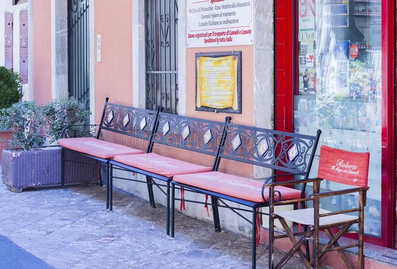 Taormina, Sicily, Italy – august 06 2018: iron benches in front of the famous pastry shop, bakery Roberto `Il mago dei cannoli`.  stock images