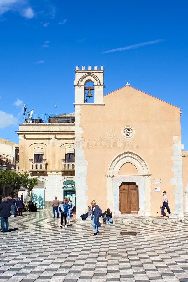Taormina, Sicily, Italy - Apr 8th 2019: People on the Piazza IX Aprile Square in beautiful historical center of the Italian city. Famous tourist spot. Travel stock photo