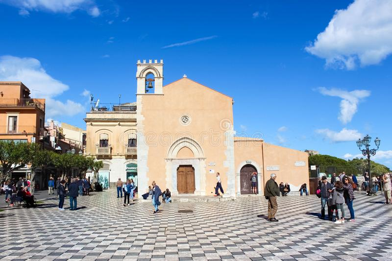 Taormina, Sicily, Italy - Apr 8th 2019: Tourists walking on the main square in the city center. Piazza IX Aprile is a popular. Tourist attraction. Beautiful royalty free stock photo
