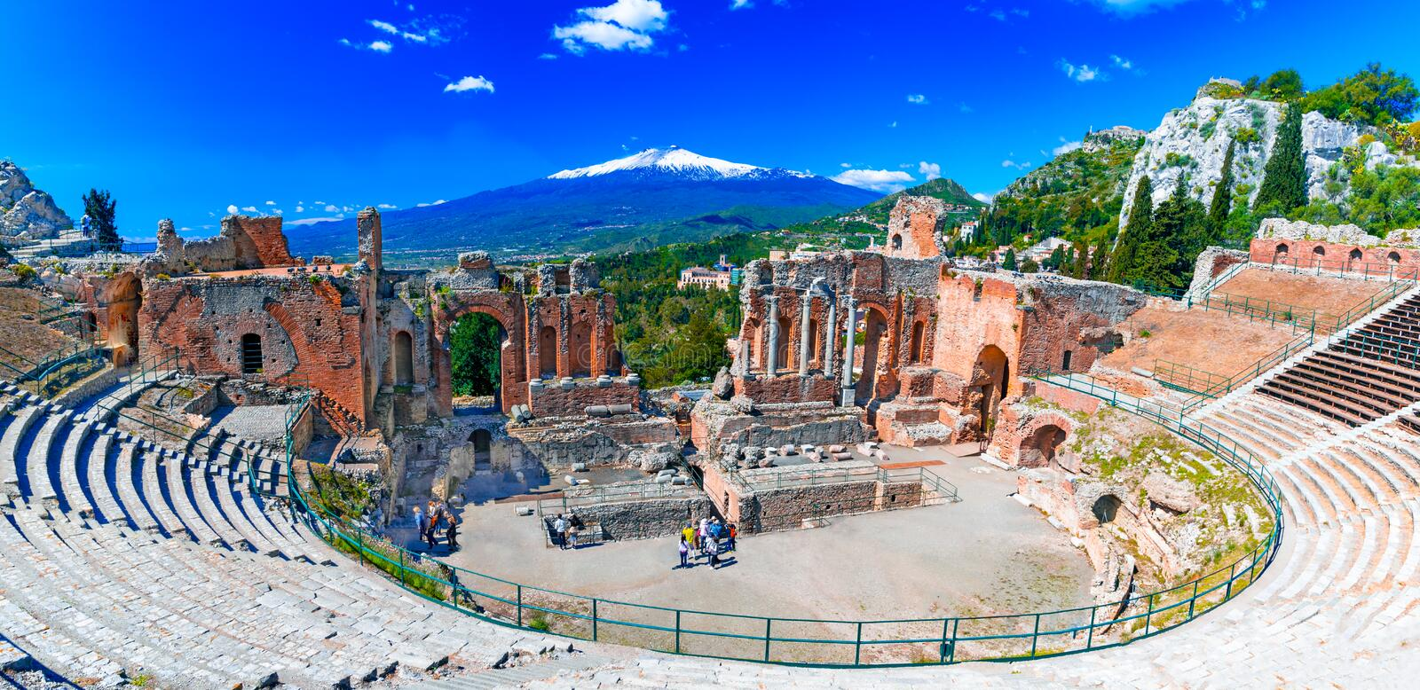 Taormina, Sicily, Italy: The Greek Theater of Taormina with smoking Etna volcano in background stock photography