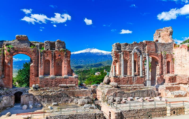 Taormina, Sicily, Italy: The Greek Theater of Taormina with smoking Etna volcano in background royalty free stock photos