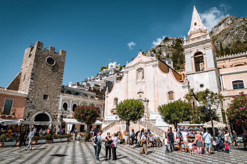 TAORMINA, SICILY / ITALY - OCTOBER 1, 2018: Church of San Giuseppe, Clock Tower and Middle Gate in Taormina city square royalty free stock photo