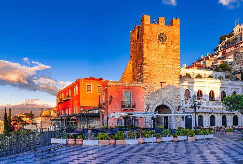 Taormina, Sicily, Italy: Panoramic view of the morning square Piazza IX Aprile with the Clock Tower and Mount Etna royalty free stock photo