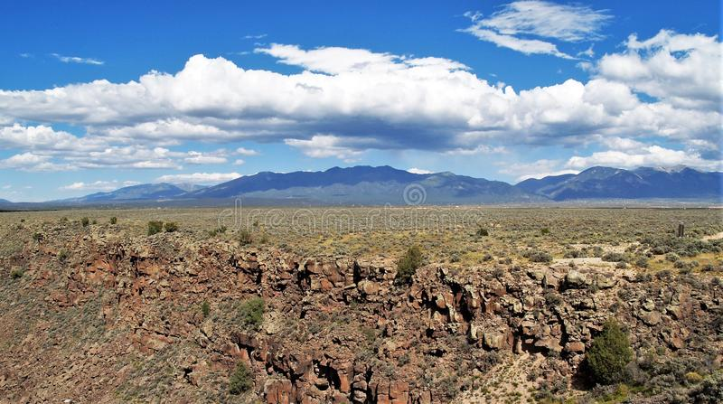 Taos, New Mexico. The mountains of northern New Mexico can be seen in the distance from the area near the Rio Grande Gorge stock images