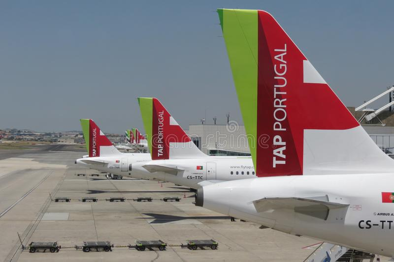 TAP Air Portugal Airbus A319-111 aircrafts parked in Lisbon. LISBON, PORTUGAL - CIRCA JUNE 2015: perspective of TAP Air Portugal Airbus A319-111 aircafts parked stock image