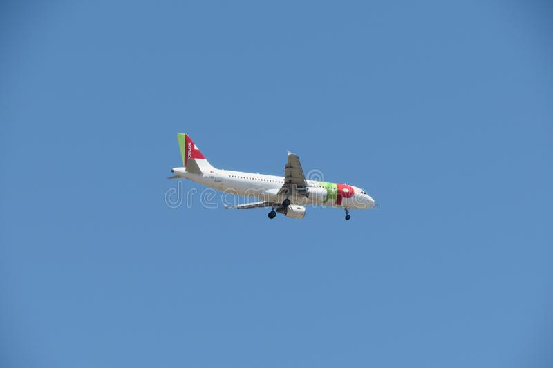TAP Air Portugal Airbus A320 flying in Lisbon. LISBON, PORTUGAL - CIRCA JUNE 2015: TAP Air Portugal Airbus A320 flying stock photo