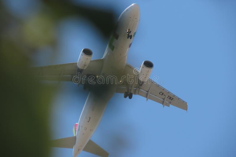 TAP Air Portugal Airbus A320 flying in Lisbon. LISBON, PORTUGAL - CIRCA JUNE 2015: TAP Air Portugal Airbus A320 flying royalty free stock images