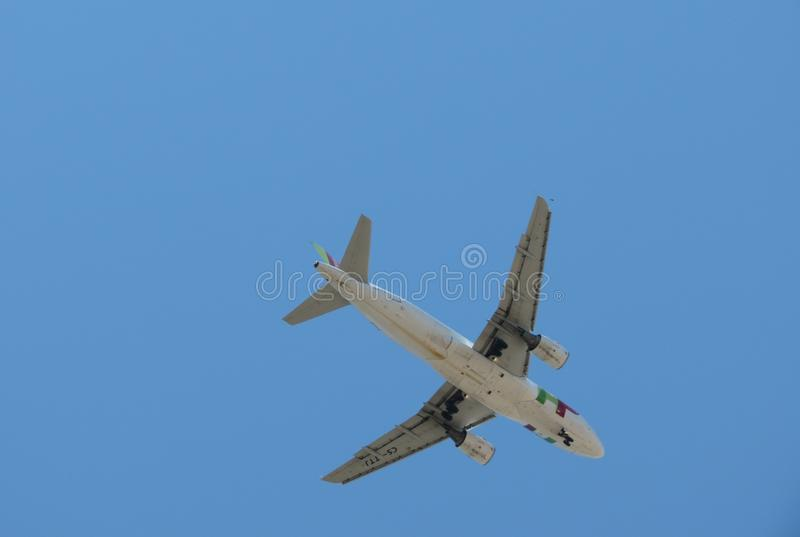 TAP Air Portugal Airbus A319 flying in Lisbon. LISBON, PORTUGAL - CIRCA JUNE 2015: TAP Air Portugal Airbus A319 flying royalty free stock photos