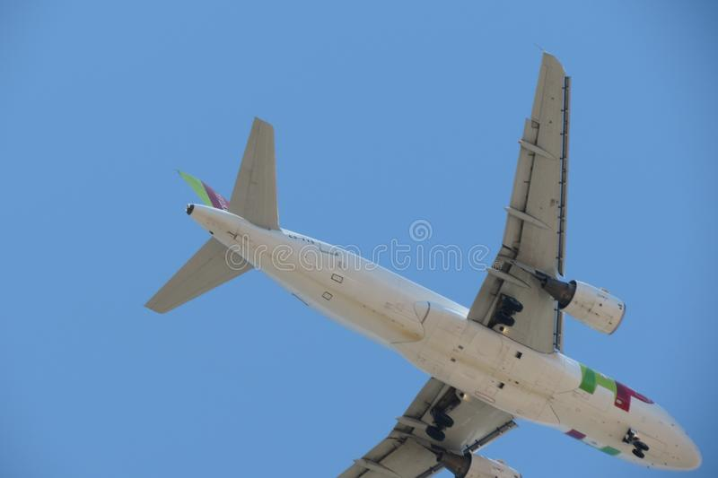 TAP Air Portugal Airbus A319 flying in Lisbon. LISBON, PORTUGAL - CIRCA JUNE 2015: TAP Air Portugal Airbus A319 flying stock image