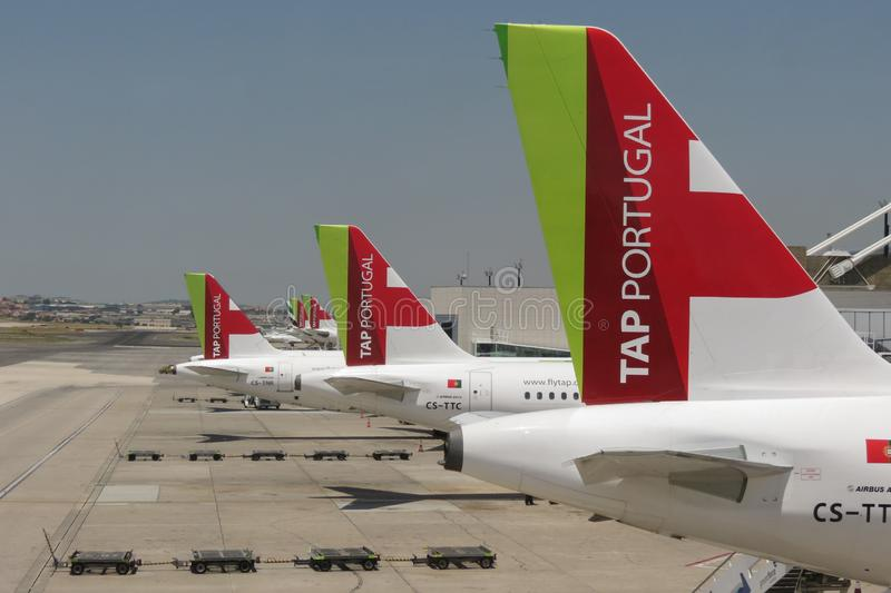 TAP Air Portugal Airbus A319 parked in Lisbon. LISBON, PORTUGAL - CIRCA JUNE 2015: TAP Air Portugal Airbus A319 and A320 aircrafts parked at the airport royalty free stock image