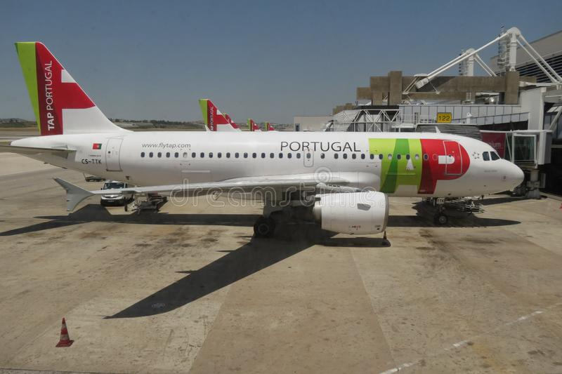 TAP Air Portugal Airbus A319 parked in Lisbon. LISBON, PORTUGAL - CIRCA JUNE 2015: TAP Air Portugal Airbus A319 and A320 aircrafts parked at the airport stock images
