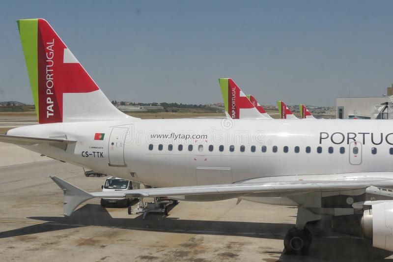 TAP Air Portugal Airbus A319 parked in Lisbon. LISBON, PORTUGAL - CIRCA JUNE 2015: TAP Air Portugal Airbus A319 and A320 aircrafts parked at the airport royalty free stock images