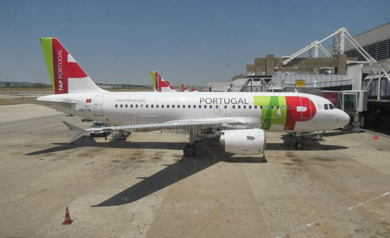 TAP Air Portugal Airbus A319-111 parked in Lisbon. LISBON, PORTUGAL - CIRCA JUNE 2015: TAP Air Portugal Airbus A319-111 parked at the airport stock image