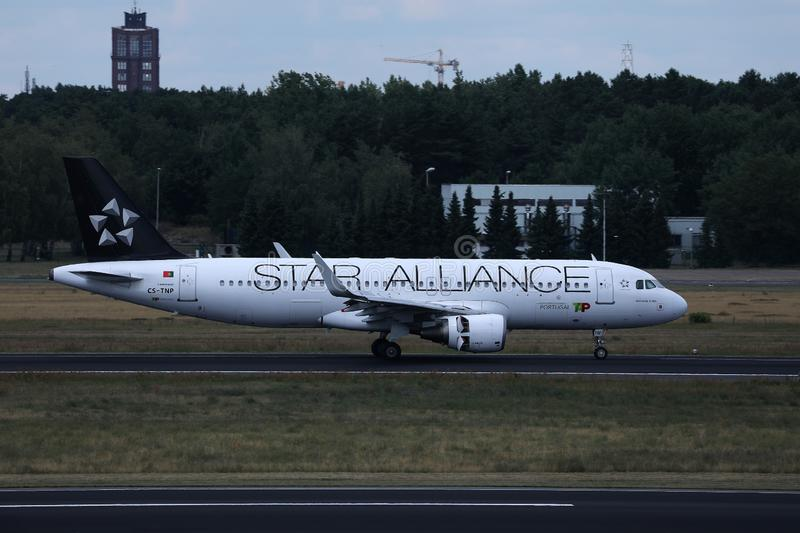 Star Alliance TAP Air Portugal plane doing taxi on runway. TAP Air Portugal airplane takes off from airport royalty free stock image
