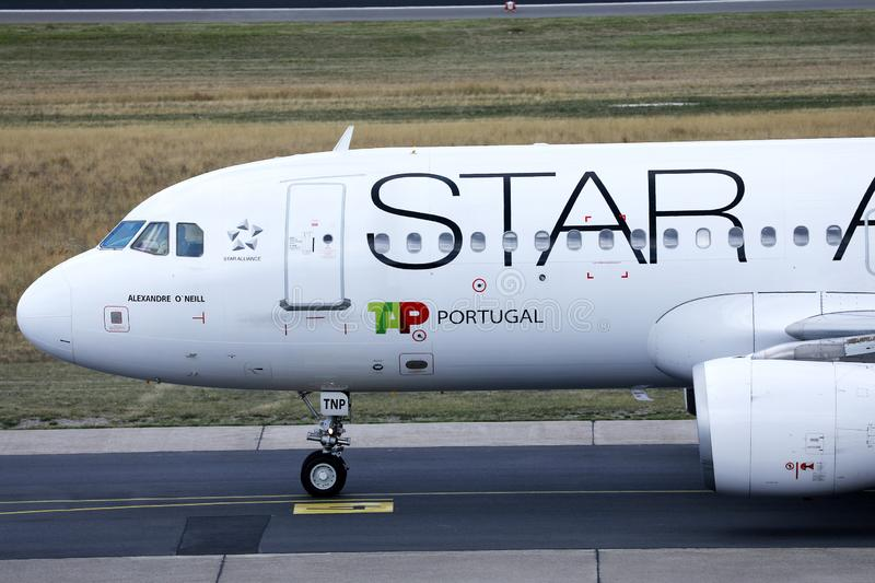 Star Alliance TAP Air Portugal plane doing taxi on runway. TAP Air Portugal airplane takes off from airport royalty free stock photography