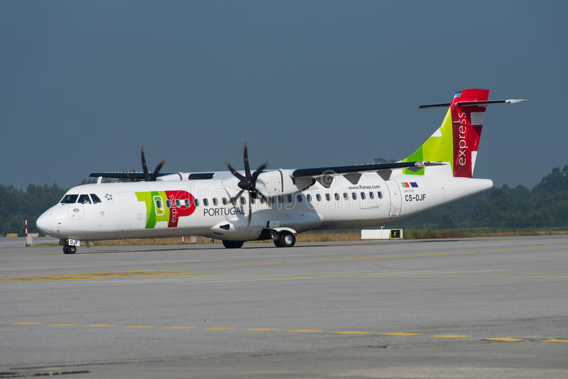 TAP - Air Portugal Express ATR 72. PORTO, PORTUGAL - AUGUST 2016 TAP - Air Portugal Express ATR 72-600 (72-212A), CS-DJF, cn 1284, operated by White taxiing to stock photography