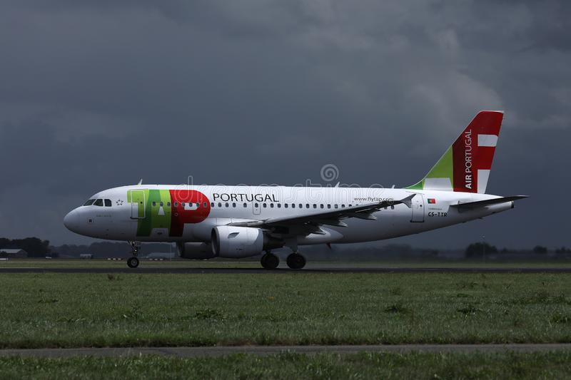 TAP Air Portugal plane doing taxi on runway, dark blue sky. TAP Air Portugal airplane takes off from airport royalty free stock photography