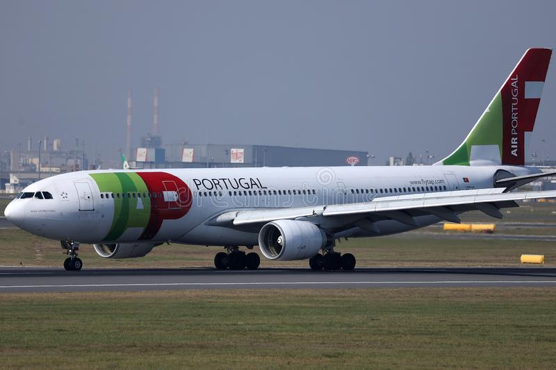 TAP Air Portugal plane doing taxi on runway. TAP Air Portugal airplane takes off from airport stock images