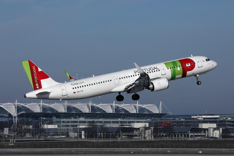 TAP Air Portugal plane flying to exotic destinations. TAP Air Portugal plane flying up in the sky, Munich Airport, MUC royalty free stock image