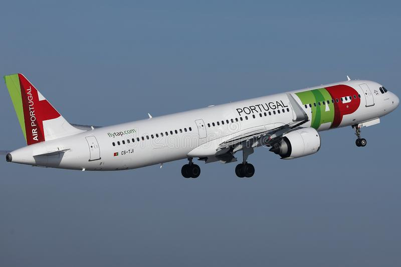TAP Air Portugal plane flying to exotic destinations. TAP Air Portugal plane flying up in the sky royalty free stock photography