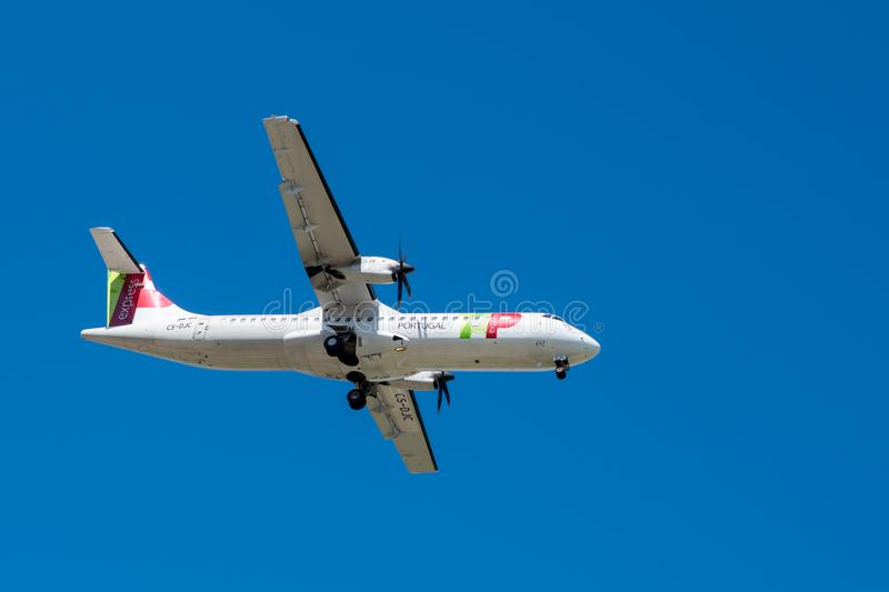 Tap Air Portugal plane in the air over Lisbon. LISBON, PORTUGAL - APRIL 18, 2018: Tap Air Portugal plane in the air over Lisbon royalty free stock photo