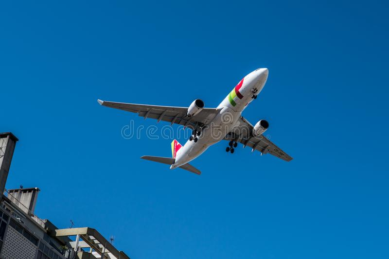 Tap Air Portugal plane in the air over Lisbon. LISBON, PORTUGAL - APRIL 18, 2018: Tap Air Portugal plane in the air over Lisbon royalty free stock images