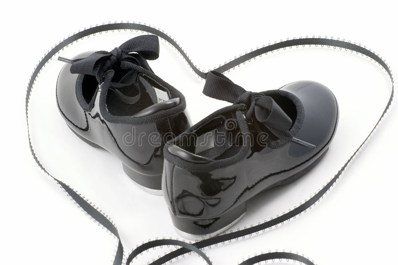 Tap dance shoes and heart royalty free stock photo