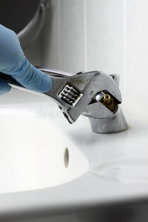 Tap fixing spanner stock photo. Image of basin, hand - 64247642