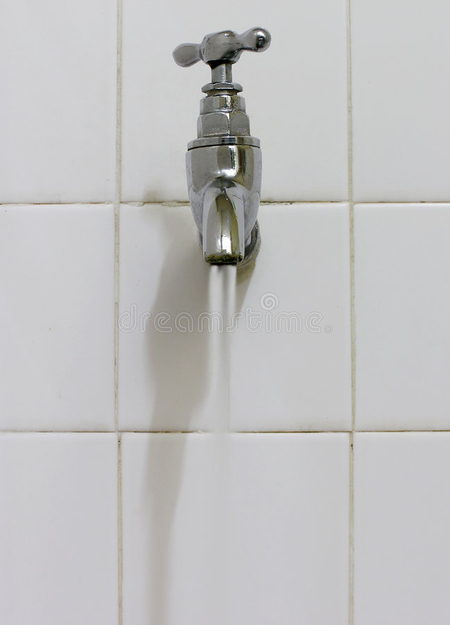 Tap flowing water stock image