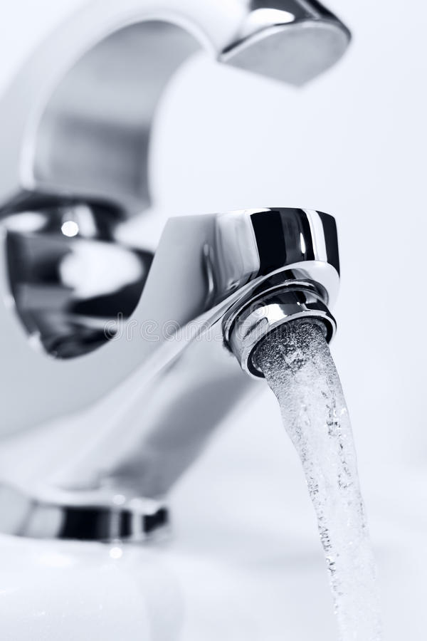 Tap with flowing water. stock photo